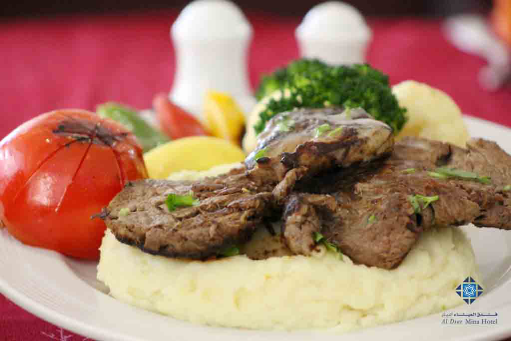 Beef steak with mashed potatoes available at Mina Restaurant and Room service