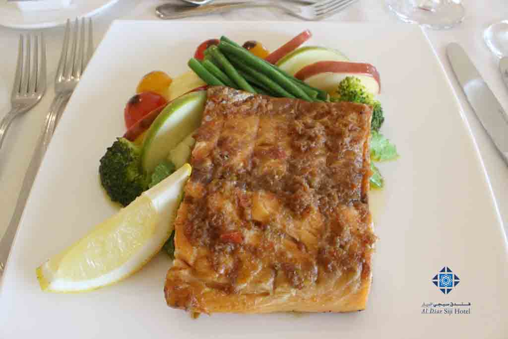 Grilled salmon with glazed apple at Al Diwan
