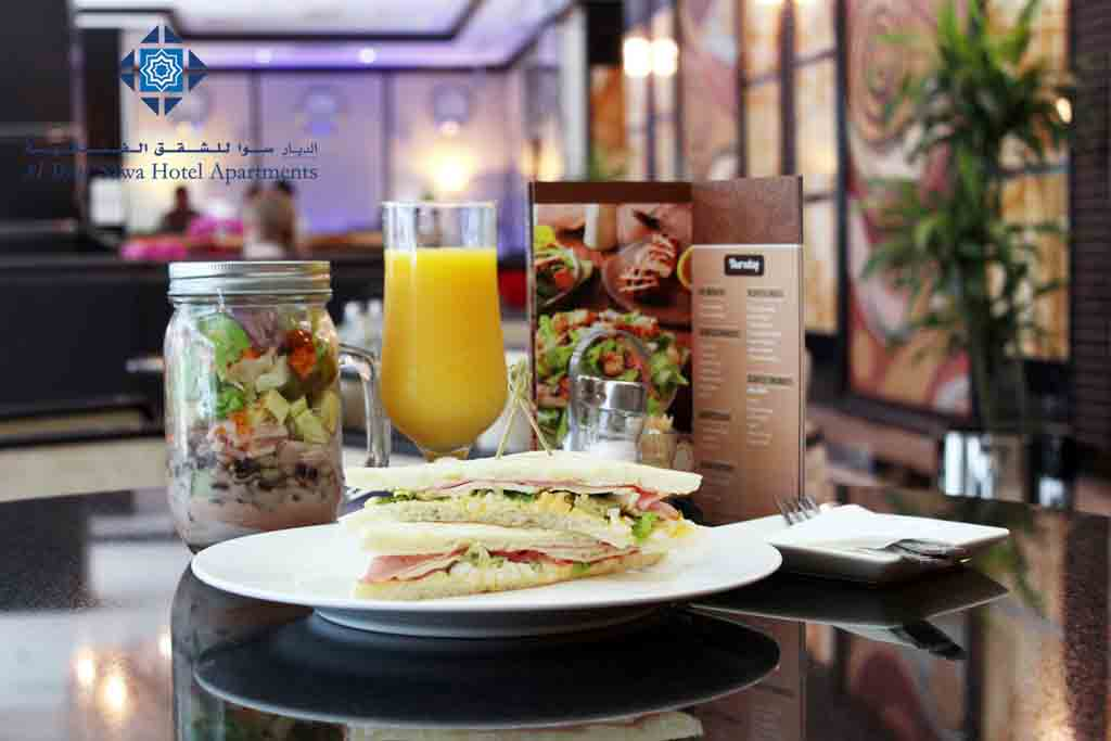 Salad, sandwich and  orange juice at Cafe Day to Day